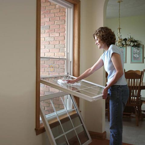 Woman Cleaning ProVia Double-Hung Windows